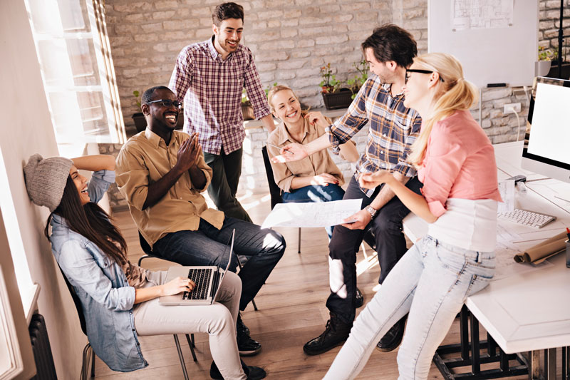 Photo-of-a-group-smiling-designers-relaxing-480586839_5616x3744